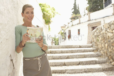 Posed : Woman with guidebook in street