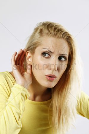Eastern european ethnicity : Woman with her hand behind ear