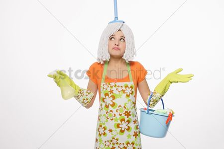 Ignorance : Woman with mop on her head carrying a pail of cleaning products