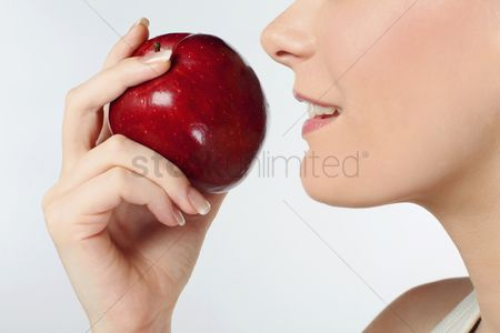 British ethnicity : Woman with red apple