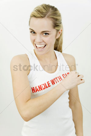 Funny : Woman with the word  handle with care  on her sleeveless top