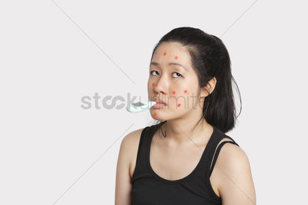 Thermometer : Woman with thermometer in mouth suffering from measles