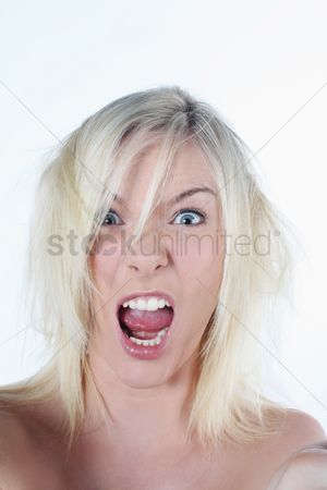 British ethnicity : Woman with tousled hair shouting frantically