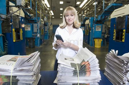 Interior : Woman working in newspaper factory portrait