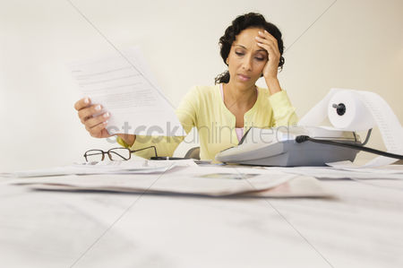 Head shot : Woman working on bills
