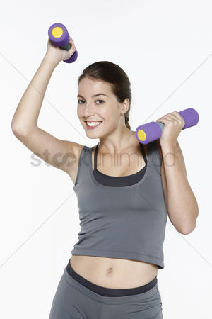 Dumbbell : Woman working out with dumbbells