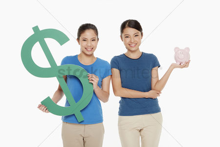 Dollar sign : Women holding up a dollar sign and a piggy bank