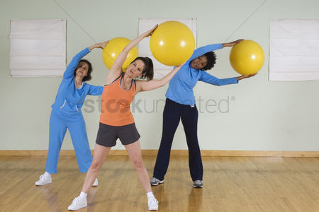 Fitness : Women using exercise balls in fitness class