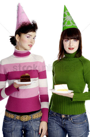 Celebrating : Women with party hat holding cake