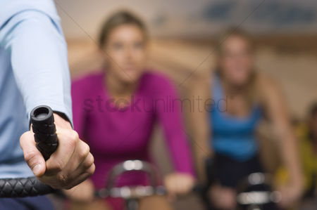 Fitness : Women working out on exercise bicycles at gym