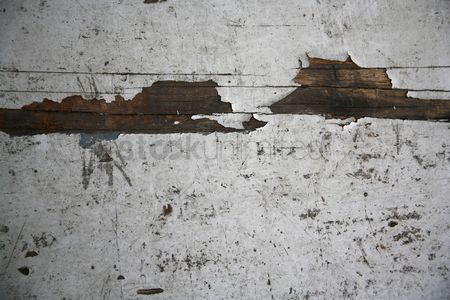 Weathered : Wooden surface with paint peeling off