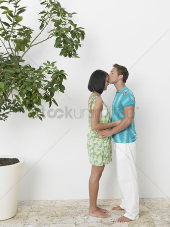 Kissing : Young affectionate couple kissing