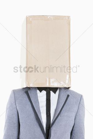Cardboard cutout : Young boy wearing jacket with box covered over his face on gray background
