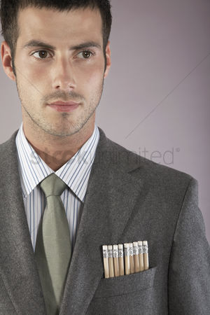 Pocket : Young businessman with pencils in pocket portrait