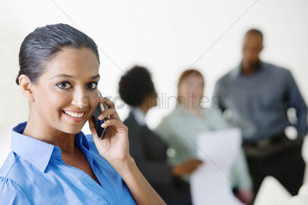 Cellular phone : Young businesswoman using cell phone