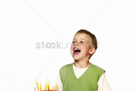 Blowing : Young child blowing out his birthday candles