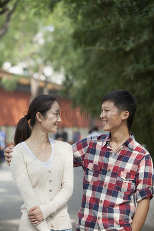 Forbidden : Young chinese couple walking in jing shan park
