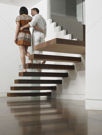 Modern lifestyle : Young couple descending stairs