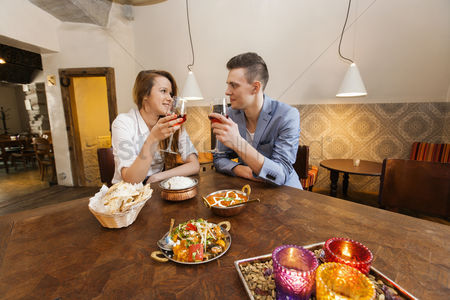 Traditional clothing : Young couple having wine at restaurant table