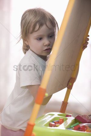 Ponytail : Young girl drawing on chalkboard