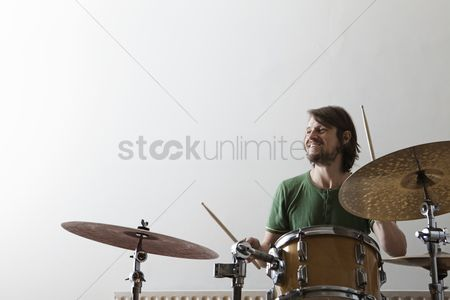 Hobby : Young man plays drums with enjoyment