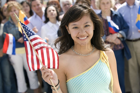 Demonstration : Young woman holding american flag portrait