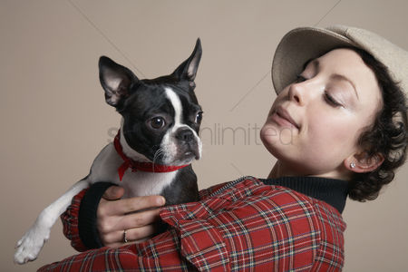 Animal head : Young woman holding french bulldog