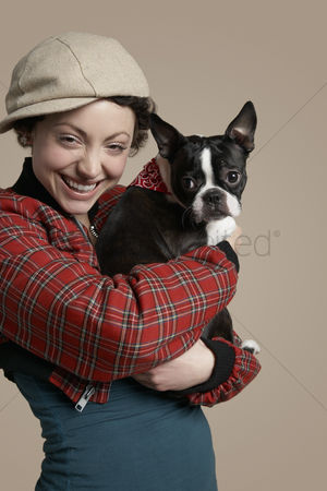Bulldog : Young woman holding french bulldog