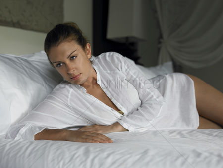 Comfy : Young woman lying on bed