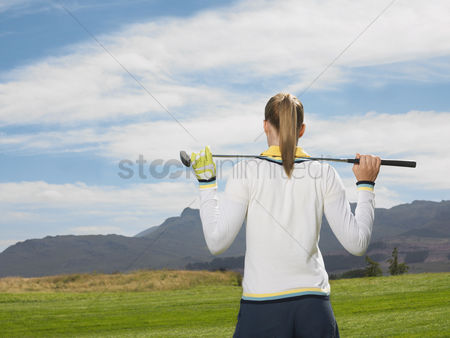 Ponytail : Young woman on golf course back view