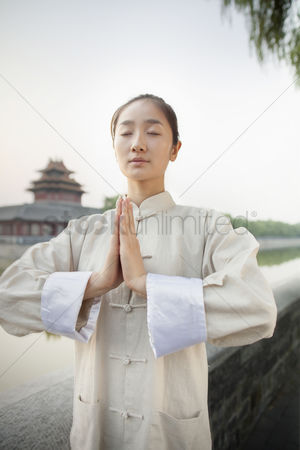 Forbidden : Young woman practicing tai ji