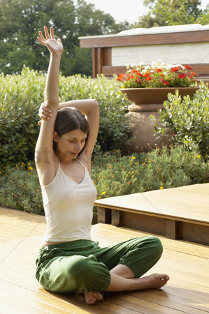Practising yoga : Young woman practising yoga portrait
