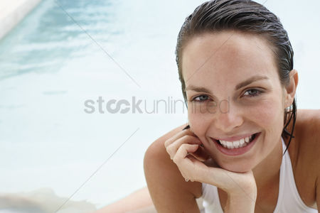 Swimmer : Young woman relaxing in swimming pool portrait close-up