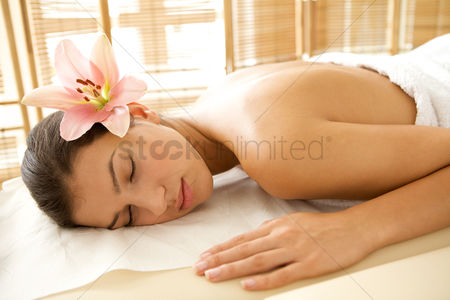 Body : Young woman relaxing on massage table  eyes closed