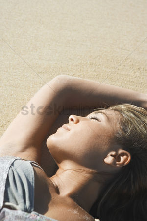 Day off : Young woman sunbathing on beach