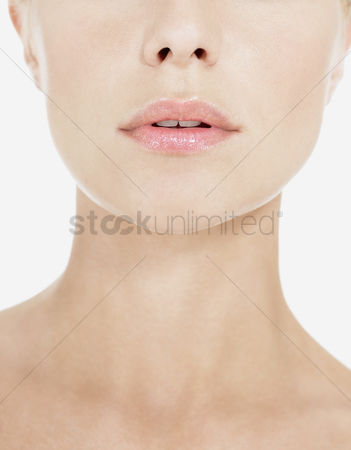 Elegance : Young woman wearing pink lipstick close up of neck