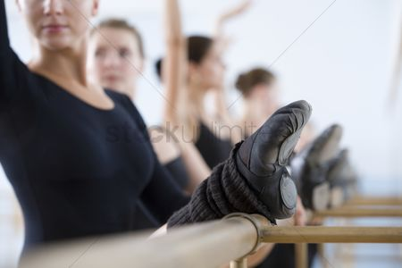Dance : Young women practising at the barre